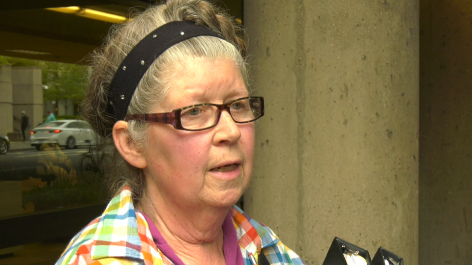 Juanna Hanlon speaks to reporters outside court, where she's battling the District of North Vancouver for more time clearing out her home. May 17, 2019.