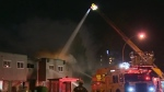 Man arrested after Victoria apartment blaze