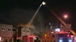 Man arrested after Victoria apartment blaze