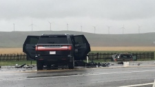 A damaged Lincoln SUV and a damaged pickup truck following a crash on Highway 3 near Cowley