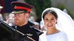 In this Saturday, May 19, 2018 file photo, Prince Harry and his wife Meghan Markle leave after their wedding ceremony, at St. George's Chapel in Windsor Castle in Windsor, near London, England. (Gareth Fuller/pool photo via AP, File)