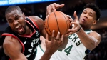 Milwaukee Bucks' Giannis Antetokounmpo tries to steal the ball from Toronto Raptors' Serge Ibaka during the second half of Game 2 of the NBA Eastern Conference basketball playoff finals Friday, May 17, 2019, in Milwaukee. (AP Photo/Morry Gash)