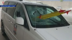 The driver of the van says that he was on Interstate 5 Thursday morning when the yellow-and-red tripod smashed through the glass.