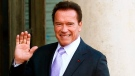 In this Dec. 12, 2017 file photo, Arnold Schwarzenegger waves as he arrives at the Elysee Palace prior to a meeting on climate change in Paris. (AP Photo/Francois Mori, File)