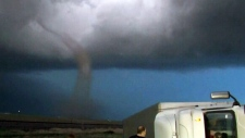 Tornadoes and flash flooding across U.S