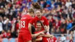 Team Canada captain Christine Sinclair (12) celebrates a goal by midfielder Jessie Fleming (17) with teammates Allysha Chapman (2) and Sophie Schmidt (13) during the first half of a women's international soccer friendly against Mexico at BMO field in Toronto, Saturday, May 18, 2019. (THE CANADIAN PRESS/Cole Burston)