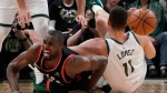 Toronto Raptors' Serge Ibaka and Milwaukee Bucks' Brook Lopez go after a loose ball during the second half of Game 2 of the NBA Eastern Conference basketball playoff finals Friday, May 17, 2019, in Milwaukee. The Bucks won 125-103 to take a 2-0 lead in the series. (AP Photo/Morry Gash)