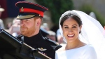 FILE - In this Saturday, May 19, 2018 file photo, Prince Harry and his wife Meghan Markle leave after their wedding ceremony, at St. George's Chapel in Windsor Castle in Windsor, near London, England. Sunday, May 19, 2019 marks the first wedding anniversary of the besotted couple. (Gareth Fuller/pool photo via AP, File)