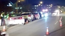 A line of cars in Saskatoon get towed away following a check stop Friday night. (Courtesy: Twitter/@SPSTraffic)