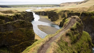"This photo taken Wednesday, May 1, 2019, shows a cliff at the Fjadrargljufur canyon in southeastern Iceland. The canyon area has suffered environmental damages after intense traffic, prompted by the music video ""I'll Show You"" by Justin Bieber. (AP Photo/Egill Bjarnason)"
