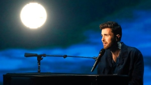"Duncan Laurence of the Netherlands performs the song ""Arcade"" during the 2019 Eurovision Song Contest grand final in Tel Aviv, Israel, Saturday, May 18, 2019. (AP Photo/Sebastian Scheiner)"