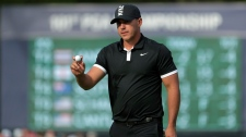 Brooks Koepka reacts after putting on the 13th green during the third round of the PGA Championship golf tournament, Saturday, May 18, 2019, at Bethpage Black in Farmingdale, N.Y. (AP Photo/Julio Cortez)
