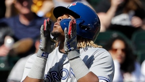 Toronto Blue Jays' Vladimir Guerrero Jr., celebrates as he rounds the bases after hitting a two-run home run during the eighth inning of a baseball game against the Chicago White Sox in Chicago, Sunday, May 19, 2019. (AP Photo/Nam Y. Huh)