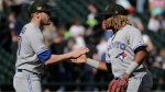 Toronto Blue Jays relief pitcher Ken Giles, left, celebrates with third baseman Vladimir Guerrero Jr., after the Blue Jays defeated the Chicago White Sox 5-2 in a baseball game in Chicago, Sunday, May 19, 2019. (AP Photo/Nam Y. Huh)