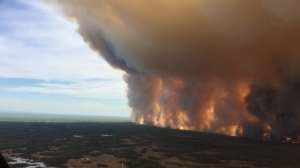 Alberta Wildfire said Sunday the Chuckegg Creek wildfire was burning out of control in the High Level Forest Area, to the southwest and west of the town of High Level. (Courtesy: Twitter / Alberta Wildfire)