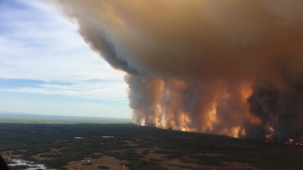 Alberta authorities warn out-of-control wildfire could cut town's electricity