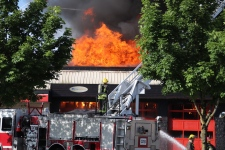 Crews had to battle the fire defensively and managed to save a third business located in the strip mall. (CTV)