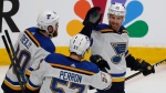 St. Louis Blues' Ryan O'Reilly, David Perron, celebrate with Jaden Schwartz, who scored a goal against the San Jose Sharks in the third period in Game 5 of the Western Conference finals on Sunday, May 19, 2019. (AP Photo/Josie Lepe)