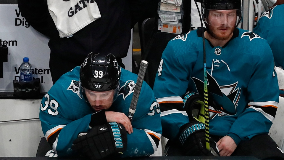 San Jose Sharks' Logan Couture and Gustav Nyquist react on the bench as the St. Louis Blues take a 5-0 lead in the third period in Game 5  in San Jose, Calif., on Sunday, May 19, 2019. (AP Photo/Josie Lepe)
