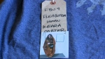 A wardrobe tag from one of Keara Carter's roles in the final season of Game of Thrones is seen here.