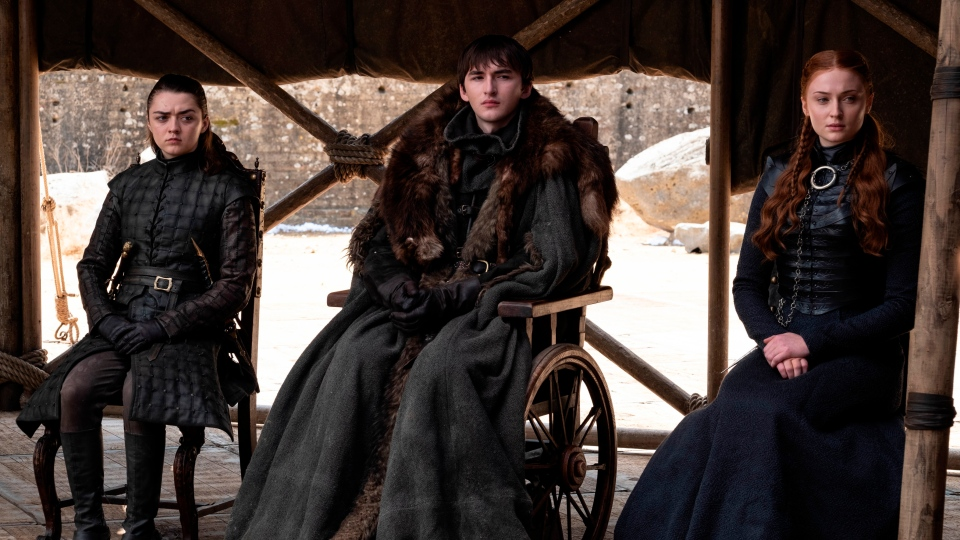 """This image released by HBO shows from left to right Maisie Williams, Isaac Hempstead Wright and Sophie Turner in a scene from the final episode of """"Game of Thrones,"""" that aired Sunday, May 19, 2019. (HBO via AP)"""