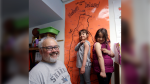 In this photo taken Wednesday, May 15, 2019, Gator Lanphear smiles as his twin six-year-old daughters Scarlett, center, and Leilani show off where on their arms they received their measles immunizations while posing for a photo in Vashon Island, Wash. (AP Photo/Elaine Thompson)