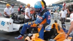 Fernando Alonso, of Spain, climbs out his car at the conclusion of qualifications for the Indianapolis 500 IndyCar auto race at Indianapolis Motor Speedway, Saturday, May 18, 2019, in Indianapolis. (AP Photo/Michael Conroy)
