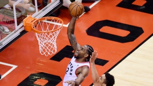 Toronto Raptors forward Kawhi Leonard (2) scores past Milwaukee Bucks guard Malcolm Brogdon (13) during the second overtime period of Game 3 NBA Eastern Conference finals basketball action in Toronto on Sunday, May 19, 2019. THE CANADIAN PRESS/Frank Gunn