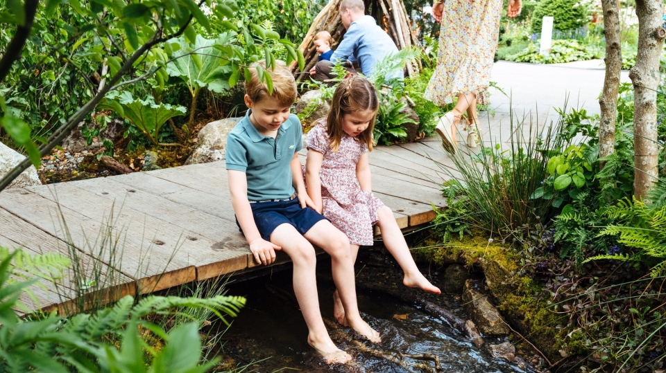 Prince George and Princess Charlotte were seen dipping their toes in the babbling stream that runs through the greenspace. (Matt Porteous)