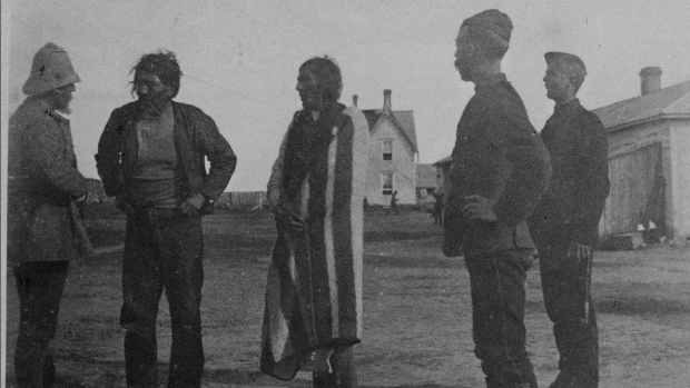 Chief Poundmaker, centre, is shown in a file photo from the 1884-1888 Northwest Rebellion. (THE CANADIAN PRESS / National Archives of Canada-- Frederic Hatheway Peters)
