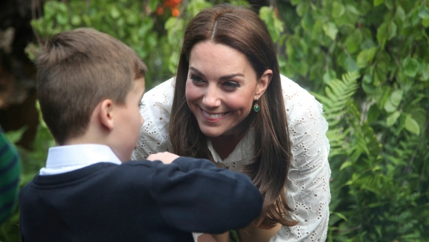 Kate, Duchess of Cambridge, left, speaks to children as she visits her garden at the RHS Chelsea Flower Show at the Royal Hospital Chelsea, London, Monday May 20, 2019. (Yui Mok/Pool via AP)