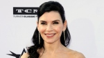 "This June 7, 2018 file photo shows Julianna Margulies at the 46th AFI Life Achievement Award Honoring George Clooney in Los Angeles. Margulies stars in the upcoming limited series ""The Hot Zone."" (Photo by Willy Sanjuan/Invision/AP, File)"