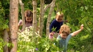 Royal children play in 'Back to Nature' garden