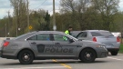 A Halton police vehicle is shown at the scene of a fatal motorcycle crash in Milton on Monday morning.
