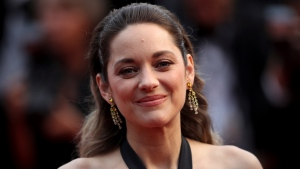 Actress Marion Cotillard poses for photographers upon arrival at the premiere of the film 'La Belle Epoque' at the 72nd international film festival, Cannes, southern France, Monday, May 20, 2019. (AP Photo/Petros Giannakouris)
