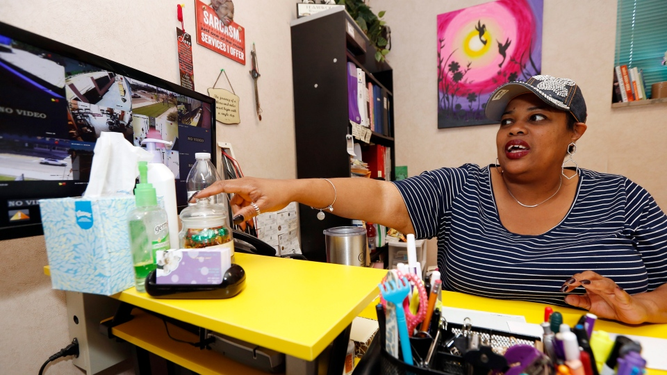 Shannon Brewer, the clinic director at the Jackson Women's Health Organization, watches a monitor with the live feed from security video cameras set throughout the property Friday, May 17, 2019, in Jackson, Miss. (AP Photo/Rogelio V. Solis)