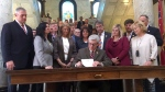 In this March 21, 2019 photo, Mississippi Gov. Phil Bryant is surrounded by lawmakers as he signs a bill that would ban most abortions once a fetal heartbeat can be detected, at the capitol in Jackson, Miss.  (AP Photo / Emily Wagster Pettus)