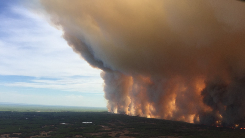 A wildfire is seen burning in this May 19, 2019 photo (AlbertaWildFire/Twitter)