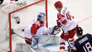 Canada's Pierre-Luc Dubois, right, scores his sides first goal past Denmark's Patrick Galbraith, left, and Denmark's Jesper Jensen Aabo, center, during the Ice Hockey World Championships group A match between Canada and Denmark at the Steel Arena in Kosice, Slovakia, Monday, May 20, 2019. (AP Photo/Petr David Josek)