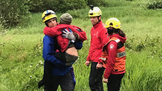 Two young children who spent the night stranded on a B.C. mountain were brought to safety by rescue crews. Their injured father had been forced to leave them to find help. (Coquitlam SAR/Twitter)