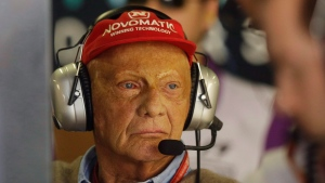 In this Nov. 10, 2017 file photo former Austrian Formula One driver Niki Lauda stands in the Mercedes pit during the first free practice at the Interlagos race track in Sao Paulo, Brazil. (AP Photo/Nelson Antoine, file)