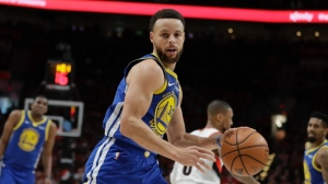 Golden State Warriors guard Stephen Curry (30) dribbles during the first half of Game 4 of the NBA basketball playoffs Western Conference finals against the Portland Trail Blazers, Monday, May 20, 2019, in Portland, Ore. (AP Photo/Ted S. Warren)