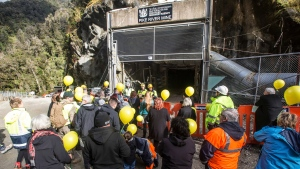 In this image released by the Pike River Recovery Agency, families gather at the entrance of the Pike River Mine, near Greymouth on the West Coast of New Zealand, Tuesday, May 21, 2019. (Neil Silverwood/Pike River Recovery Agency via AP)