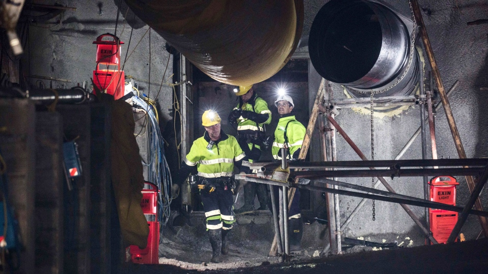 In this image released by the Pike River Recovery Agency, workers react after the first of the two airlock doors was opened in the Pike River Mine, near Greymouth on the West Coast of New Zealand, Tuesday, May 21, 2019. (Neil Silverwood/Pike River Recovery Agency via AP)