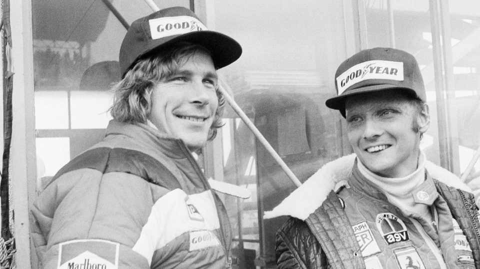 FILE - In this Oct. 24, 1976, file photo, Austrian auto racer Niki Lauda, right, defending champion in world driving, and James Hunt, of Britain, look at the rain before the start of the Japan Grand Prix Formula One auto race at Fuji International Speedway, Gotemba, Japan. (AP Photo/Nick Ut, File)