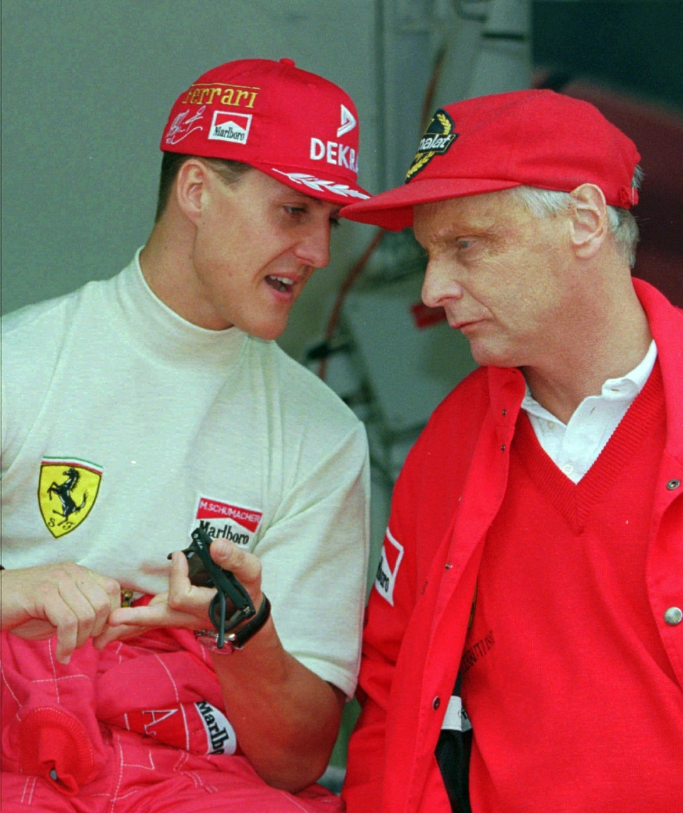 FILE - In this Thursday May 16, 1996 file photo defending champion Michael Schumacher of Germany, left, chats with Ferrari consultant Niki Lauda during the practice session for the Monaco F1 Grand Prix in the principality. (AP Photo/Lionel Cironneau, File)