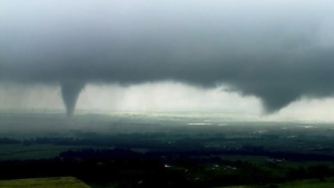 Two funnel clouds formed in Crescent, Okla.