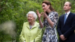 Queen Elizabeth II visits the 'Back to Nature' garden with Prince William and Kate, Duchess of Cambridge at the RHS Chelsea Flower Show at the Royal Hospital Chelsea, London, Monday May 20, 2019. (Geoff Pugh/Pool via AP)