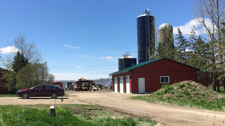 The remnants of a dairy barn seen still smouldering a day after the fire. (Natalie van Rooy / CTV Kitchener)