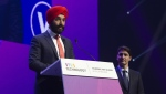 Canadian Prime Minister Justin Trudeau looks on as Innovation, Science and Economic Development Minister Navdeep Bains speaks at the Viva Technology conference in Paris, Thursday May 16, 2019. THE CANADIAN PRESS/Adrian Wyld